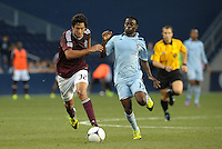 Rapids forward Tony Cascio (32) chases the ball with Sporting midfieder Peterson Joseph (19)..Sporting Kansas City defeated Colorado Rapids 2-0 in Open Cup play at LIVESTRONG Sporting Park, Kansas City, Kansas.