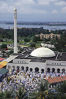 Abidjan, Cote d'Ivoire, Ivory Coast.  Riviera Mosque.  Worshippers leaving the mosque after the Eid al-Adha prayers.