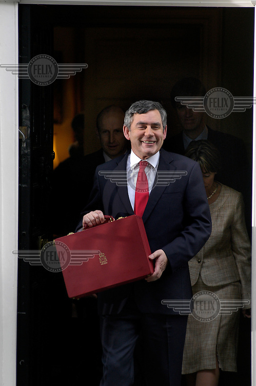 Gordon Brown, Chancellor of the Exchequer, holds the traditional red box as he makes his way to the House of Commons to deliver his Budget.