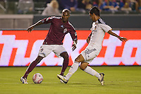 Colorado Rapids forward Omar Cummings attempting to move around A.J. DeLaGarza of the LA Galaxy. The Colorado Rapids defeated the LA Galaxy 3-2 at Home Depot Center stadium in Carson, California on Saturday October 16, 2010.