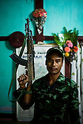 34 year old Yathong Dimasa, the commander of the Laison office of Ceasefire group of Dima Halam Daogan (DHD) poses for a portrait in his office at the camp in Dibari, Haflong (North Cachar Hills) in Assam, India.