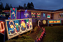 WA07265-00...WASHINGTON - House decorated for Christmas in Edmonds.