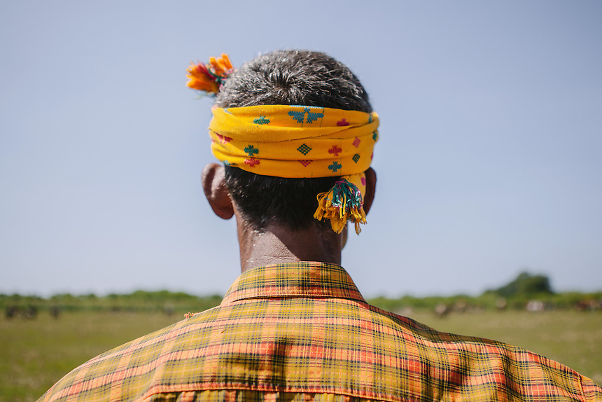 A spectator dressed with traditional Sumbanese headress during the Pasola in Homba Kalayo, Kodi. Pasola is an ancient tradition from the Indonesian island of Sumba. Categorized as both extreme traditional sport and ritual, Pasola is an annual mock horse warfare performed in response to the harvesting season. In the battelfield, the Pasola warriors use blunt spears as their weapon. However, fatal accident still do occurs.