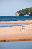 The mouth of the Salmon Trout River at Lake Superior near Big Bay Michigan with Salmon Trout Point in background.