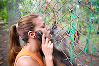 Vanessa Lizano with a spider monkey at her Costa Rica Wildlife Sanctuary run by Vanessa Lizano and her family. Moin, Limon, Costa Rica.