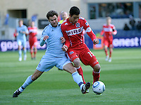 Sporting KC midfielder Graham Zusi (8) knocks Chicago Fire forward Orr Barouch (15) off the ball.  The Chicago Fire defeated Sporting KC 3-2 at Toyota Park in Bridgeview, IL on March 27, 2011.