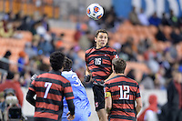 Houston, TX -  Friday, December 9, 2016: Adam Mosharrafa (16) of the Stanford Cardinal goes up for a header in the first half against the North Carolina Tar Heels  at the  NCAA Men's Soccer Semifinals at BBVA Compass Stadium.