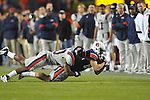 Auburn wide receiver Dimitri Reese (84) is tackled by Ole Miss' Aaron Garbutt (20) at Jordan-Hare Stadium in Auburn, Ala. on Saturday, October 29, 2011. Ole Miss was called for offsides on the play. Auburn won 41-23..