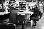 Waiting for a milk shake, twirling her hair just like she did as a kid 40 years ago? Port Townsend WA drug store soda fountain.