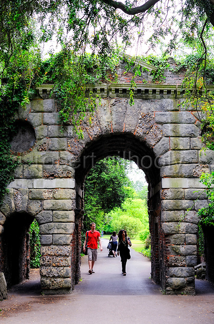 Ruined Arch, Kew Gardens, Richmond, Surrey. The Ruined Arch in Kew Gardens was designed by Sir William Chambers in 1759-60. It was built as a folly, it's ruined state today not much different than how it would have looked upon construction. The building of such structures to decorate ornamental gardens was popular at the time among the wealthy elite.