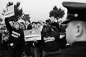 Hershey, Pennsylvania.USA.October 21, 2004..A hand full of anti-Bush demonstrators are surrounded by nearly 25,000 Bush supporters at a Bush rally. The police move in to keep them apart with dogs and horses.