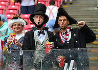 USA fans dressed as former Presidents cheer their side on