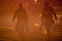 Firefighters attend a massive fire in a neighborhood at Elizabeth in New Jersey. United States. 04/18/2012.  Photo by Eduardo Munoz Alvarez / VIEWpress.