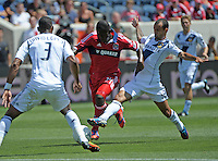 LA Galaxy defender David Junior Lopes (3) awaits as teammate Juninho (19) challenges Chicago midfielder Patrick Nyarko (14).  The LA Galaxy defeated the Chicago Fire 2-0 at Toyota Park in Bridgeview, IL on July 8, 2012.