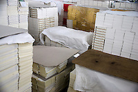 "Newly printed, uncovered Bible pages sit ready to continue the production process at the Amity Printing Company's new printing facility in Nanjing, China. ..On May 18, 2008, the Amity Printing Company in Nanjing, Jiangsu Province, China, inaugurated its new printing facility in southern Nanjing.  The facility doubles the printing capacity of the company, now up to 12 million Bibles produced in a year, making Amity Printing Company the largest producer of Bibles in the world.  The company, in cooperation with the international organization the United Bible Societies, produces Bibles for both domestic Chinese use and international distribution.  The company's Bibles are printed in Chinese and many other languages.  Within China, the Bibles are distributed both to registered and unregistered Christians who worship in illegal ""house churches."""