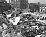 Rubble covered a number of trucks that were smashed while parked in a lot off Bank Street near the railroad tracks. Loose stone and huge railroad ties showered down on the vehicles.