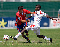 Alexander Gonzalez (20) of Panama pokes the ball away from William Fernandez (2) of Costa Rica during the quarterfinals of the CONCACAF Men's Under 17 Championship at Catherine Hall Stadium in Montego Bay, Jamaica. Panama defeated Costa Rica, 1-0.