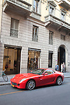 Valentino Shop with Ferrari outside in Monte Napoleone Street in Milan, Italy