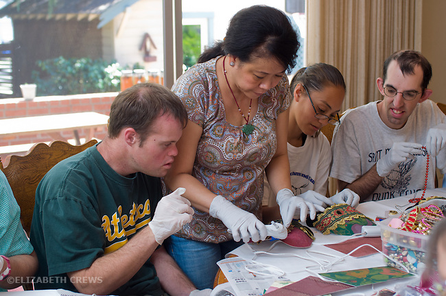 Concord CA, Intellectually handicapped adults being helped with mask-making project at their residential home  MR
