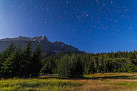 The Big Dipper and Arcturus (just over the mountain top) over Cascade Mountain in Banff National Park, Alberta. Taken July 29, 2012 with Canon 5D MkII and 16-35mm lens for 48s at f/4 and ISO 800. Moonlight from waxing gibbous Moon (off camera) provides the illumination. Taken from Upper Bankhead picnic area on Lake Minnewanka loop road.