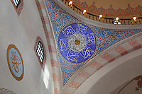 Detail of the decorative ceiling of the Gazi Husrev-beg Mosque, built 1530-32, with kufic Arabic script in the circular design, Sarajevo, Bosnia and Herzegovina. The complex includes a maktab and madrasa (Islamic primary and secondary schools), a bezistan (vaulted marketplace)and a hammam. The mosque was renovated after damage during the 1992 Siege of Sarajevo during the Yugoslav War. Picture by Manuel Cohen