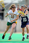 9 April 2008: University of Vermont Catamounts' Midfielder Megan MacDonald, a Freshman from Wayland, MA, is checked by University of New Hampshire Wildcats' Midfielder Michaela Hardy, a Junior from Reading, MA, at Moulton Winder Field, in Burlington, Vermont. The Catamounts rallied to defeat the visiting Wildcats 9-8 in America East divisional play...Mandatory Photo Credit: Ed Wolfstein Photo