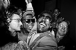 """NEW YORK - AUGUST 13:  American R&B and soul singer Wilson Pickett (1941-2006), center, immediately after  performsing at a party for the release of the film """"The Commitments"""" on August 13, 1991  in New York City, New York. The film's director, Alan Parker, is on far right. (Photo by Catherine McGann).Copyright 2010 Catherine McGann"""