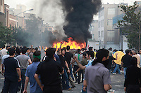 Demonstrators on Khosh Street set light to a barricade. Following a disputed election result, thousands of supporters of opposition candidate Mir-Hossein Mousavi took to the streets in protest.