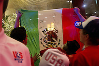 USA fans sign a Mexican flag after returning to the Galeria Plaza hotel. The USA tied Mexico at their World Cup Qualifier at Azteca stadium in Mexico City, Mexico on March 26, 2013.
