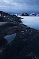 Stormy weather over rugged coastline, Vestvågøy, Lofoten Islands, Norway