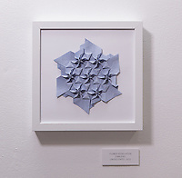 Surface to Structure origami exhibition at Cooper Union, New York. Gallery view. Flower Tessellation designed and folded by Evan Zodl 2012)