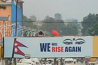 Nepal, Kathmandu, earthquake relief efforts. We Will Rise Again logo on bridge at New Road.