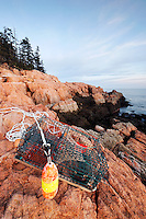 Lobster trap washed up on pink granite rocky shoreline, Mount Desert Island, Acadia National Park, near Bar Harbor, Maine, USA