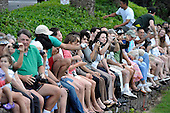 Kailua, Hawaii - December 29, 2008 -- Well wishers in sit on a stone fence as they watch U.S. President-elect Barack Obama as he leaves after a round of golf with friends in Kailua, Hawaii on Monday, December 29, 2008. Obama and his family arrived in his native Hawaii December 20 for the Christmas holiday..Credit: Joaquin Siopack - Pool via CNP