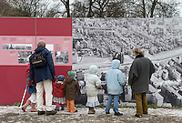 Tourists at the Berlin Wall Memorial at Bernauer Strasse in Berlin.
