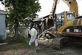 Saint Bernards Parish, Louisiana.May 26, 2006..Demolition teams work at leveling as many as 6,000 homes in St. Bernard's Parish damaged by hurricane Katrina in August of 2005..