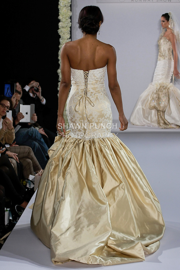 Model walks runway in a Gia bridal gown from the Katerina Bocci 2013 collection, at the Couture Runway Show, during New York Bridal Fashion Week at The Hilton Hotel, October 13, 2012.