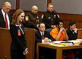 Manassas, VA - March 9, 2004 -- Katrina Hannum, daughter of sniper victim Linda Franklin, second from left, passes in front of the defense table as convicted Beltway Sniper John Allen Muhammad, second from right, his attorneys Peter Greenspun, center, and Jonathan Shapiro, right, prior to his being sentenced to death for the shooting of Dean Meyers at the Prince William County (Virginia) Circuit Court, Manassas, Virginia on March 9, 2004.  Hannum provided witness impact testimony to the court. Prince William County (Virginia) Commonwealth Attorney Paul Ebert is left. .Credit: Steve Helber - Pool via CNP