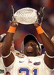Florida Gators safety Major Wright is all smiles as he lifts the crystal football from the BCS National Championship trophy after the Gators defeated the Oklahoma Sooners 24-14 in the 2009 FedEx BCS National Championship NCAA football game in Miami January 08, 2009.