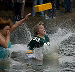 Ken Kietter looses his cheesehead while plunging into the Burley Lagoon during the 24th annual Polar Bear Jump in Olalla, Washington on January 1, 2008. Jim Bryant Photo. ©2010. ALL RIGHTS RESERVED.