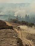 Greeley Hill, California - July 28, 2008- Wildfires Threaten Yosemite National Park .Dozer moves down Division M of   Branch Three of the Telegraph Fire  Monday afternoon.  This part of the fire is on the north side of the Merced River and is heading toward the community of Greeley Hill. .Photo by Al GOLUB/Golub Photography.
