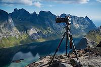 Camera and tripod in mountain landscape, Moskenesøy, Lofoten Islands, Norway