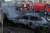 KIRKUK, IRAQ:  The scene of a triple car bomb...At 6 am, three car bombs detonated in the peaceful Kurdish neighborhood of Imam Kasimin Kirkuk.  There were 17 casualties.  Kirkuk is Iraq's most ethnically mixed city and is one month away from a volatile census that will determine the future of the city...Photo by Ari Mohammad/Metrography.