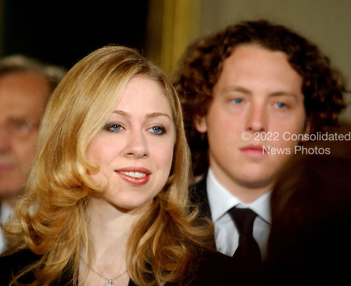 Chelsea Clinton, left,  at the White House ceremony where her parent's portraits were unveiled at the White House in Washington, D.C. on June 14, 2004.  At right is Ian Klaus..Credit: Ron Sachs / CNP
