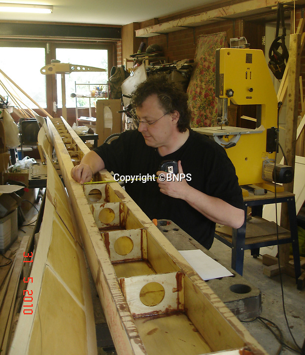 BNPS.co.uk (01202 558833)<br /> Pic: PhilYeomans/BNPS<br /> <br /> Early days - Peter at work on the wing spars in his garage.<br /> <br /> Dreaded Red Baron to fly again...WW1 Ace's feared 'Fokker Dreidecker' to finally fly over Britain.<br /> <br /> A German GP based in Norfolk has spent 8 years building a Fokker triplane in his garage as a tribute to infamous WW1 Ace Manfred von Ricthofen, who terrorised the skies over the Western front during the first war.<br /> <br /> Dr Peter Brueggemann, 52, will fulfil his childhood dream and emulate the notorious German fighter pilot when the Dreidecker Dr.1 fighter finally achieves lift-off this summer.<br /> <br /> Dr Brueggemann has even acquired the title Baron from the independent territory of Sealand so he can take to the skies as Baron Peter von Brueggemann in homage to his idol.<br /> <br /> The GP at the Holt Medical Practice in Norfolk hopes to be airborne in a few months once tests on the engine are completed at Felthorpe airfield near Norwich where he has devoted thousands of hours to the project.<br /> <br /> The father-of-two, who has lived in England with wife Sue for 20 years, has been taking flying lessons since his project began.