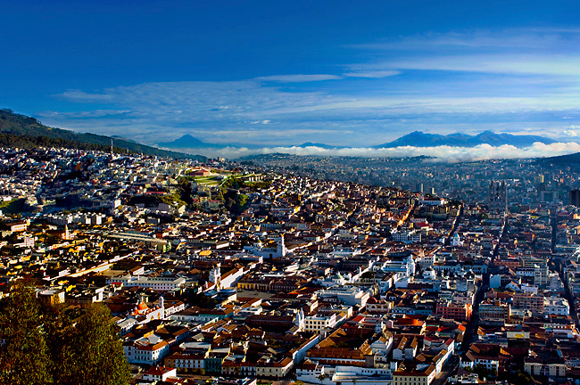 Surrounded by volcanic Andean mountains, the colonial architecture of Quito is seen from this elevated view from El Panecillo.  The old quarter has been declared a UNESCO World Cultural Heritage Site.