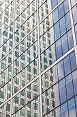 One Canada Tower at Canary Wharf reflected in the glass fa&ccedil;ade of 8 Canada square. <br />