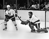 NorthStars 1970 against the Seals, Stars #27 Marshall Johnston with goalie Gump Worsley. (photo/Ron Riesterer)
