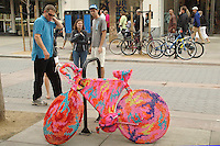 "People look at ""Bike-like object no. 9"" by Polish artist Olek at the Third Street Promenade on Friday, October 15, 2010."