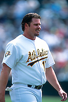 OAKLAND, CA - Jason Giambi of the Oakland Athletics walks off the field during a game at the Oakland Coliseum in Oakland, California in 2001. Photo by Brad Mangin